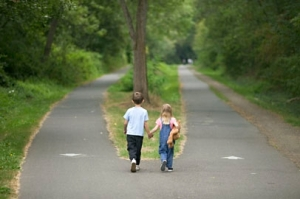 Children holding hands while standing on road